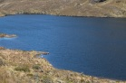 Lagune et son Pêcheur au Parc National d'El Cajas